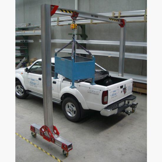 Mobitrac modular crane lifting into ute