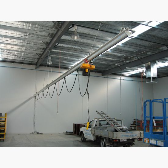 Roof mounted monorail crane with electric hoist