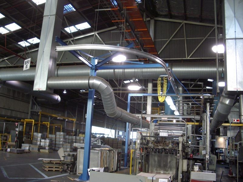 Curved monorail crane retrofitted to existing factory