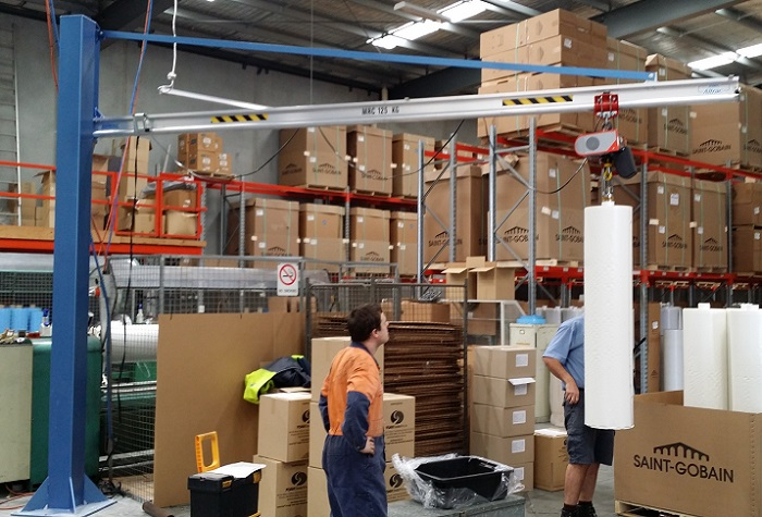 Altrac jib crane lifts 125kg rolls of foam to load into cutting machine